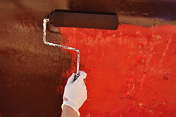 Rolling the paint on